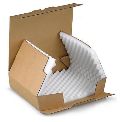 Bruna stansade lådor med skuminlägg