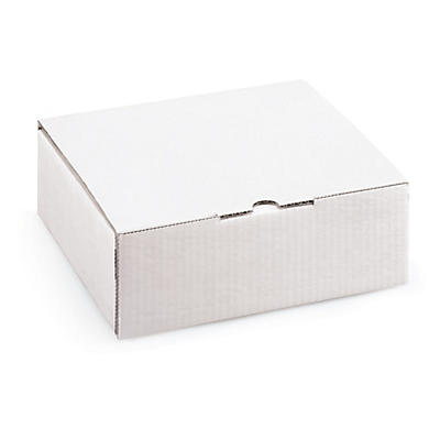Vita stansade lådor med skuminlägg