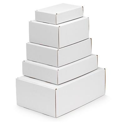 Vita stansade lådor